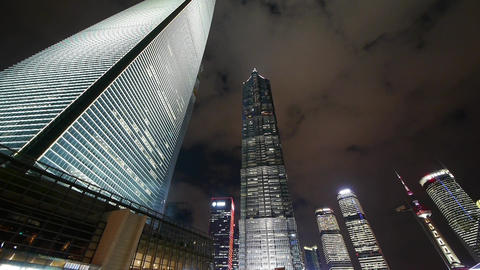 time lapse,cloud flying shanghai huanqiu skyscraper & pearl-tower at night Animation
