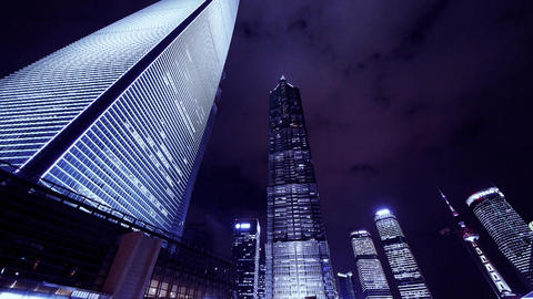 time lapse,cloud flying modern urban skyscraper at night Stock Video Footage