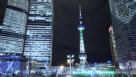 time lapse,people passing shanghai skyscraper & orient pearl TV tower at nig Animation