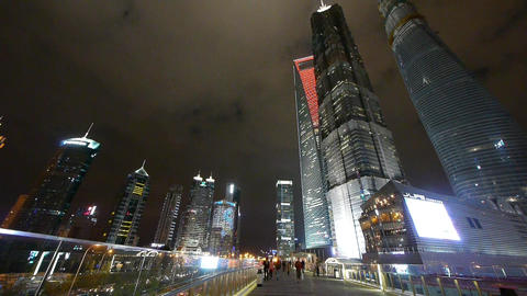 urban traffic & peole at night,Brightly lit shanghai pudong building Animation