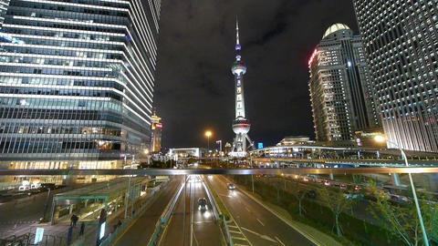 city traffic & brightly lit urban economic skyscraper... Stock Video Footage