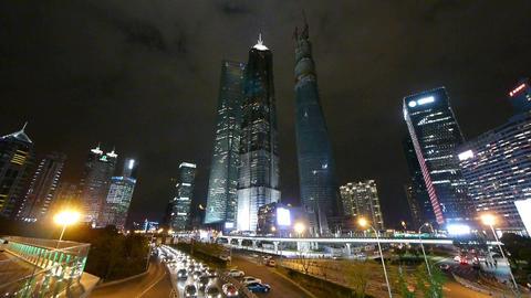 urban traffic & skyscraper,night illuminated... Stock Video Footage