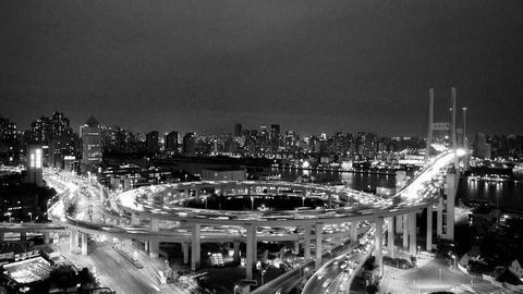 timelapse night heavy traffic on highway interchange,Brightly lit cityscape Animation