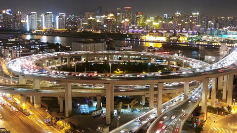 night heavy traffic on highway interchange,Brightly lit... Stock Video Footage