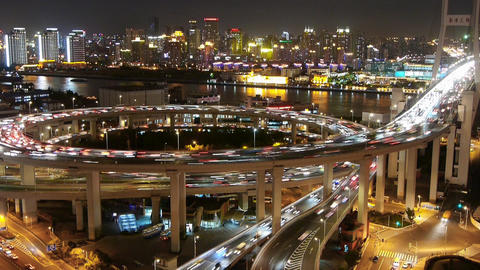 the light trails of city traffic on highway interchange... Stock Video Footage