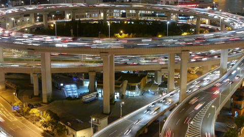 timelapse the light trails of urban traffic on highway at... Stock Video Footage