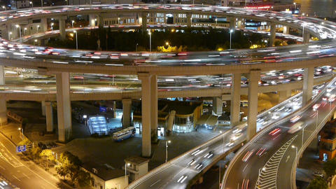 timelapse the light trails of urban traffic on highway at night Animation