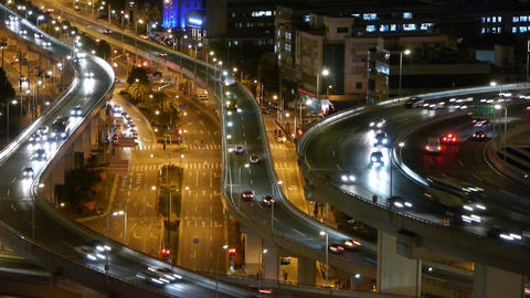 closeup of urban traffic on overpass interchange at night Stock Video Footage
