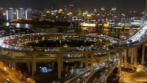 night heavy traffic on overpass interchange,Brightly lit... Stock Video Footage