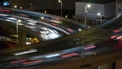 the light trails of fast moving cars on overpass,city... Stock Video Footage