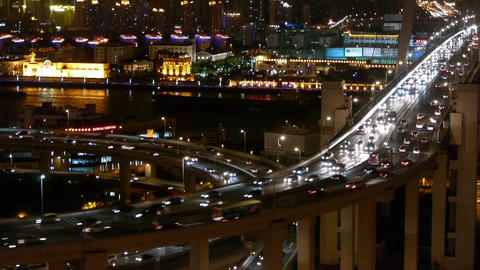 slow moving cars on overpass interchange,Brightly lit urban building,shanghai Animation