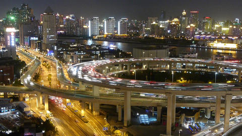 time lapse,busy urban traffic on overpass bridge at night,shipping on river Animation