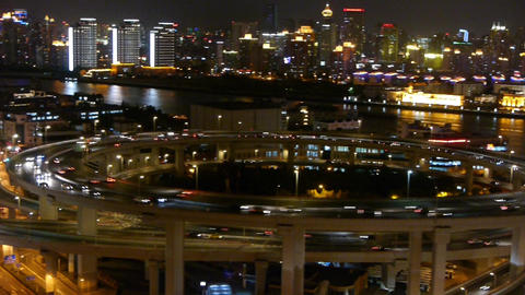 panoramic of busy urban traffic on overpass bridge at night,shipping on river Animation