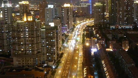 time lapse busy urban traffic with streaking lights trail... Stock Video Footage