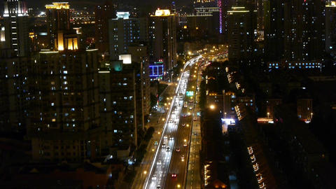 time lapse busy urban traffic jam at night,urban morden building background Animation
