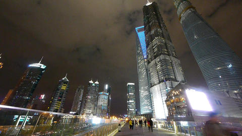 people passing urban business skyscraper at night,shanghai landmark building Animation