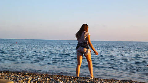 Young beautiful girl spinning on the beach by the Stock Video Footage