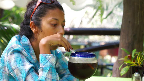 Young woman enjoying a drinnk Stock Video Footage