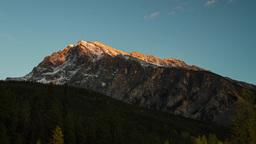 Sunset light shinning on Mountain clip 04 Stock Video Footage