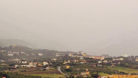 Village in mountain valley fog hides. Sicily, Ital Footage