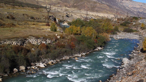 Fast, clean, mountain river flowing among stones Stock Video Footage