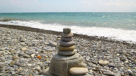 The pyramid of stones is on the beach Stock Video Footage