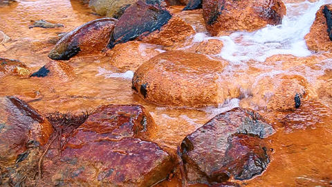 Mineral Water With Iron Flows Over The Rocks stock footage