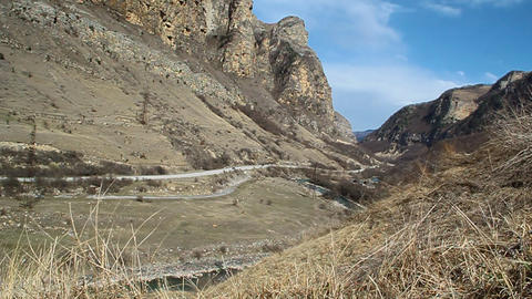 Gorge road in the mountains, moving cars Stock Video Footage