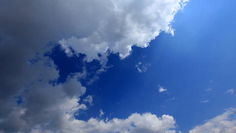 white fluffy clouds over blue sky Stock Video Footage