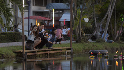 Young Thai Couple Praying and Releasing a Krathong Stock Video Footage