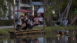 Young Thai Couple Praying and Releasing a Krathong Footage