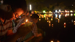 Thai Woman Praying Before Releasing a Krathong Dur Stock Video Footage