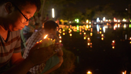Thai Woman Praying Before Releasing a Krathong Dur Footage