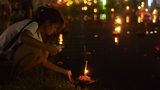 Thai Couple Releasing Krathong's into a Pond Durin Footage