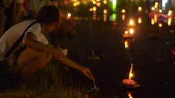 Thai Couple Releasing Krathong's into a Pond Durin Stock Video Footage