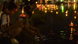 Young Thai Woman Floating Krathong in Pond in Bang Stock Video Footage