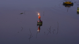 Flower Krathong Floating In Pond At Dusk During Th stock footage