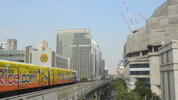 Trains Arriving at a Skytrain Station in Bangkok Stock Video Footage