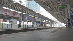 Passenger Train Arriving at a BTS Skytrain Station Stock Video Footage