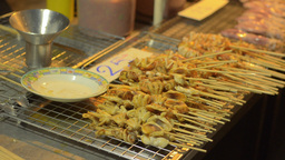 Skewers of Squid Grilling over a Charcoal Fire Stock Video Footage