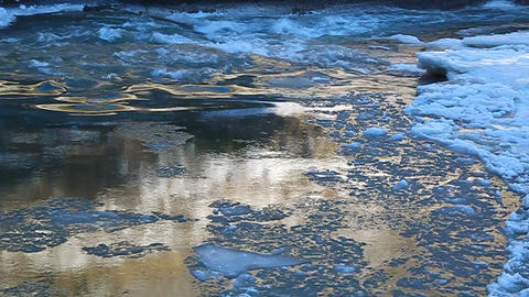 Floe floating on the river, illuminated by golden  Footage