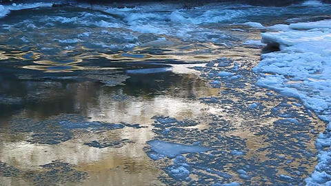 Floe floating on the river, illuminated by golden Stock Video Footage