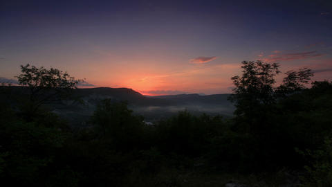 Timelapse sunrise in the mountains. Cave city Mang Stock Video Footage