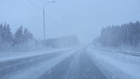 Snowing on the road Stock Video Footage