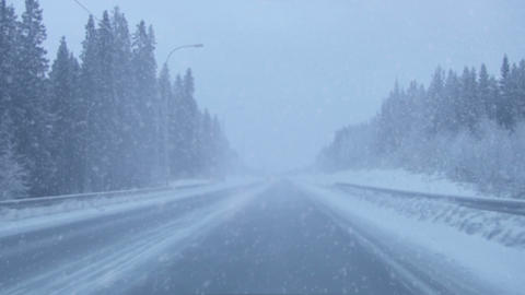 Snowing on the road Footage