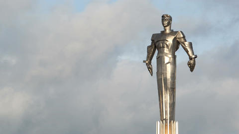 Time lapse of clouds running behind Yuri Gagarin m Stock Video Footage
