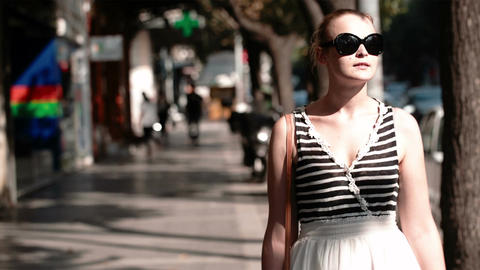 Young woman in sunglasses Stock Video Footage