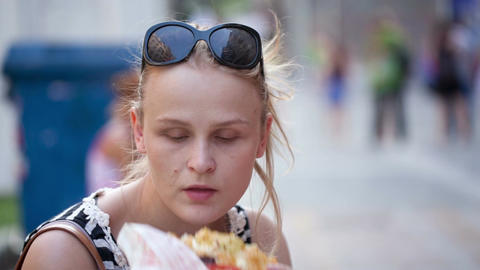 Young woman eating Stock Video Footage