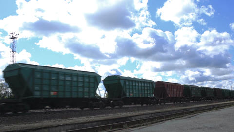 The freight train is passing by on a sunny day Stock Video Footage