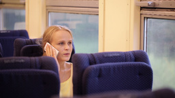 Woman talking on the phone being on the train Stock Video Footage